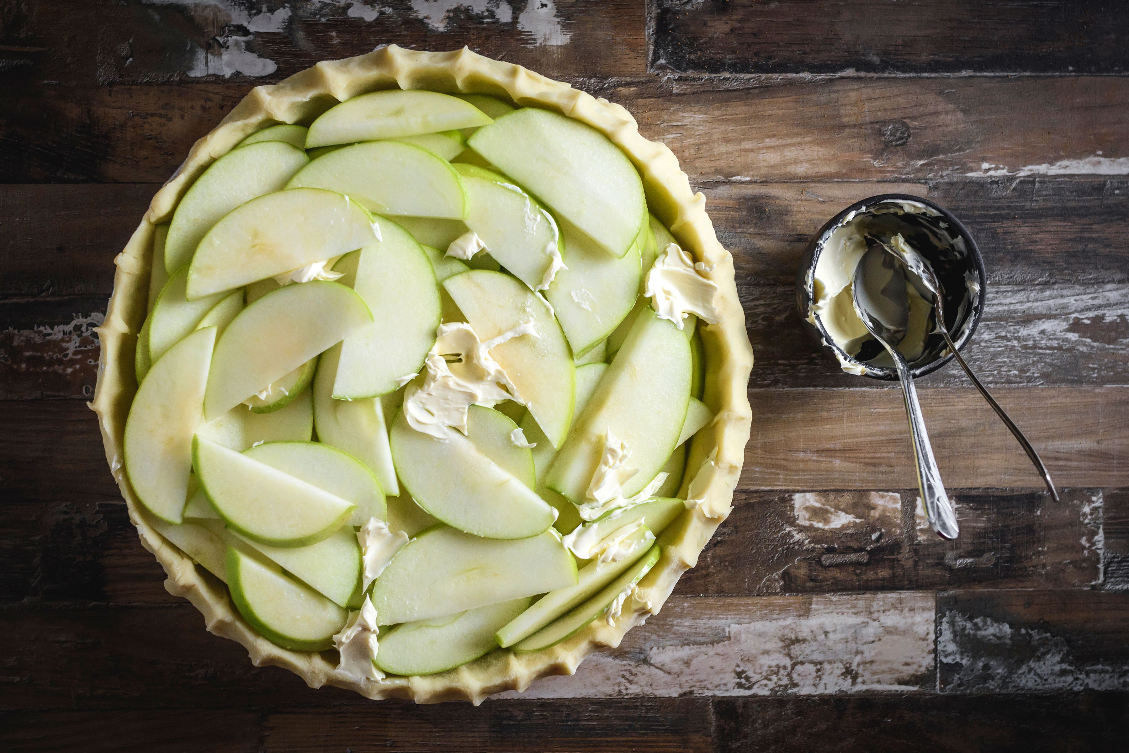 Place apple slices in crust