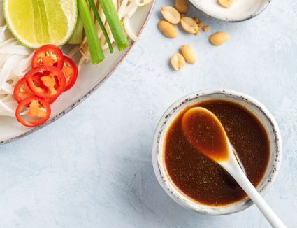A small bowl of pad thai sauce ready for a noodle dish