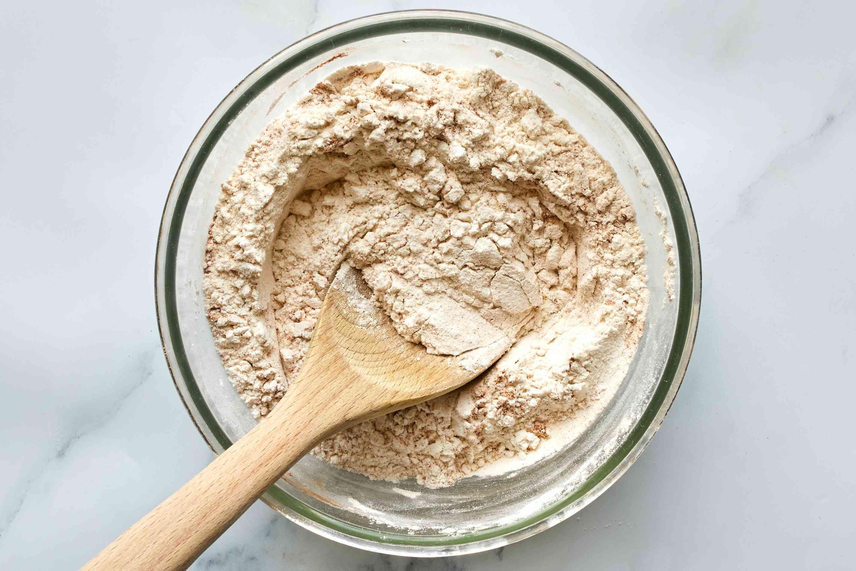 flour, soda, baking powder, cinnamon, nutmeg, and salt in a bowl
