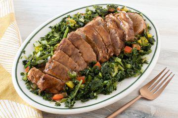 pork tenderloin on a platter with kale