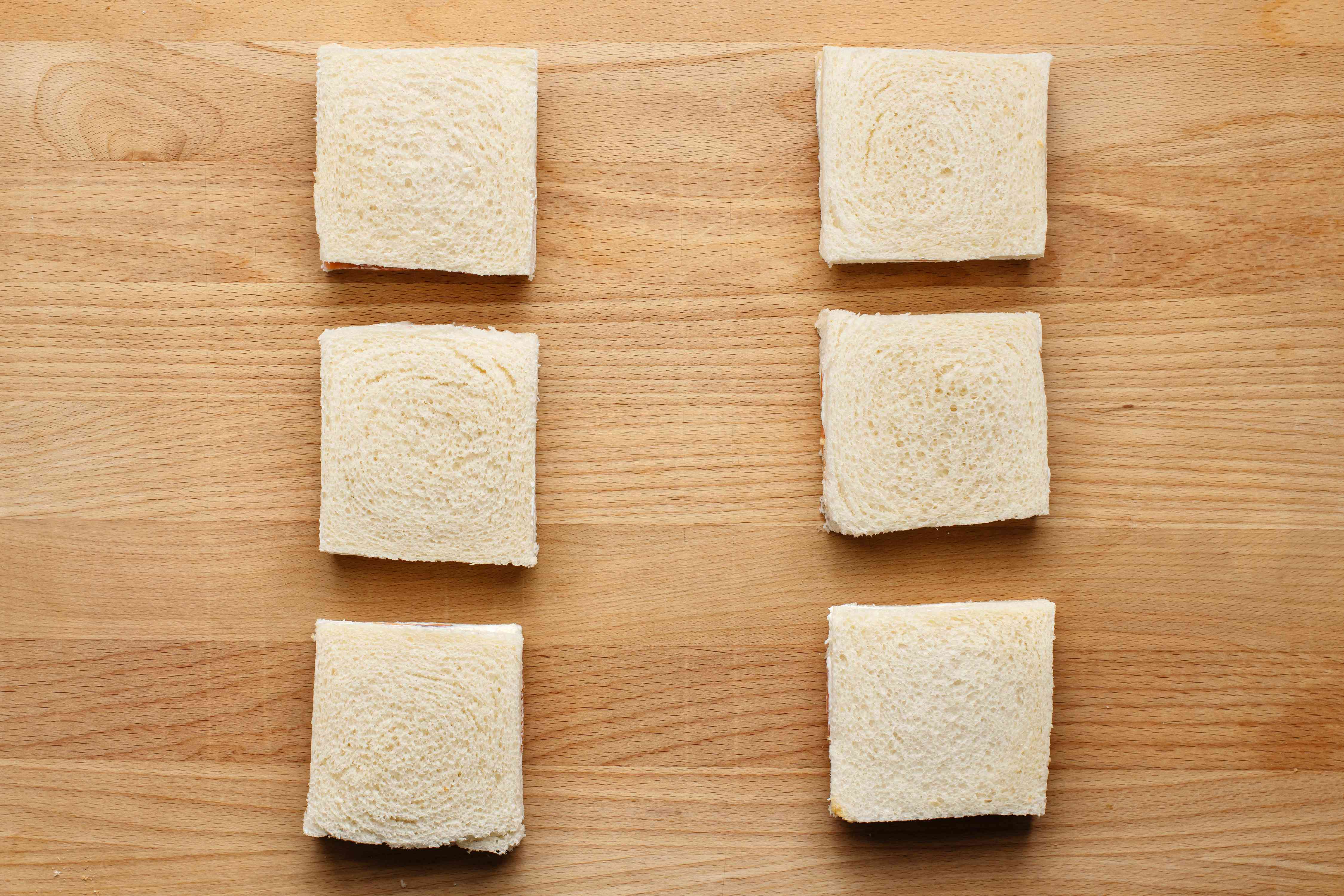 Put the slices together and cut off the crusts