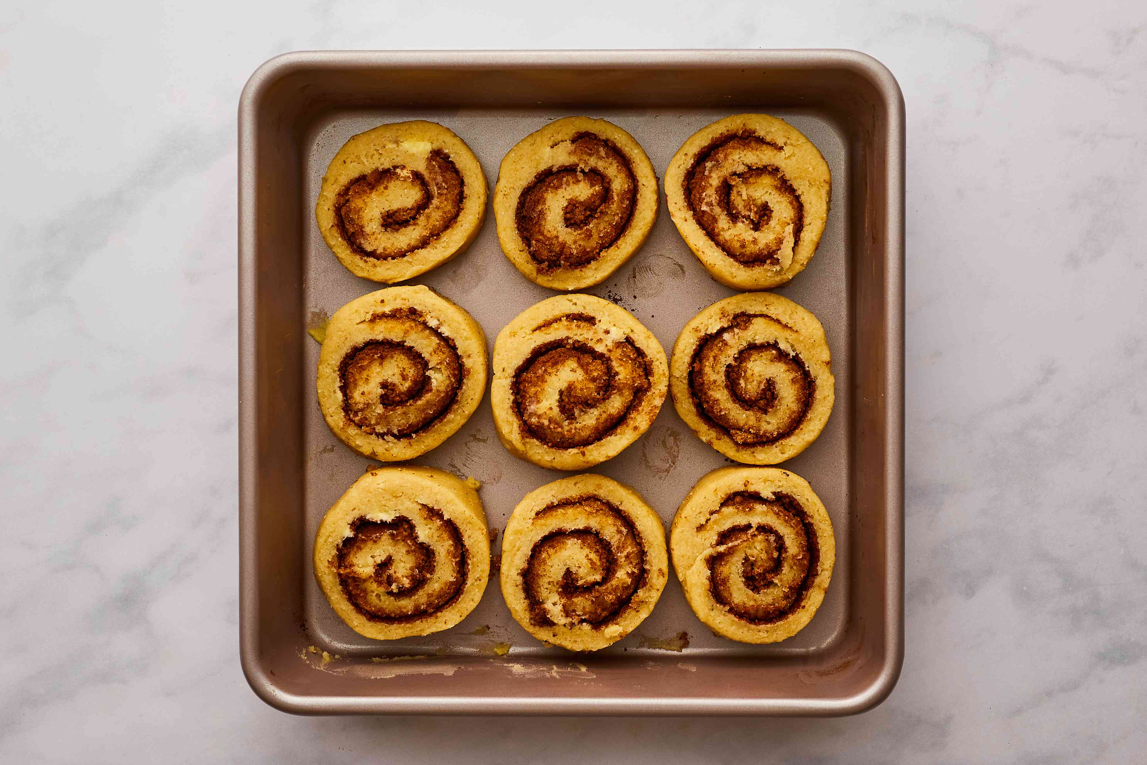 cinnamon rolls cut and in pan ready to bake