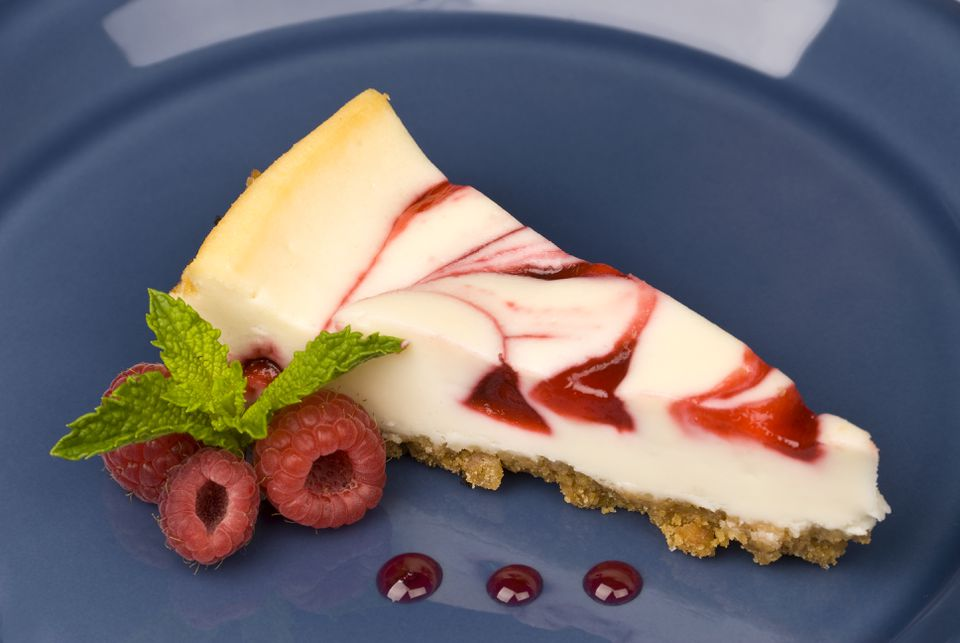 A slice of raspberry swirl cheesecake.