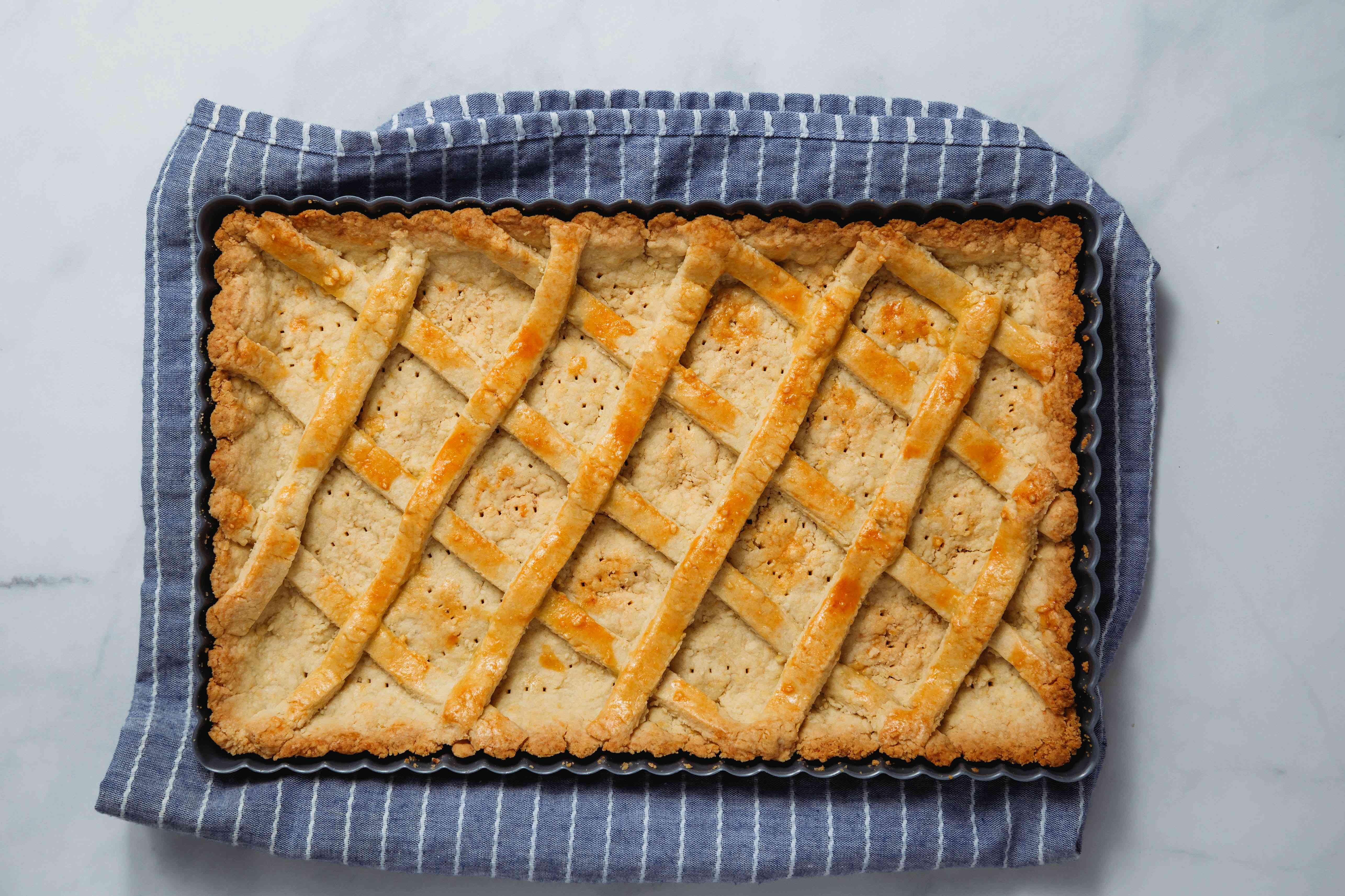 tart dough baked in pan resting on towl