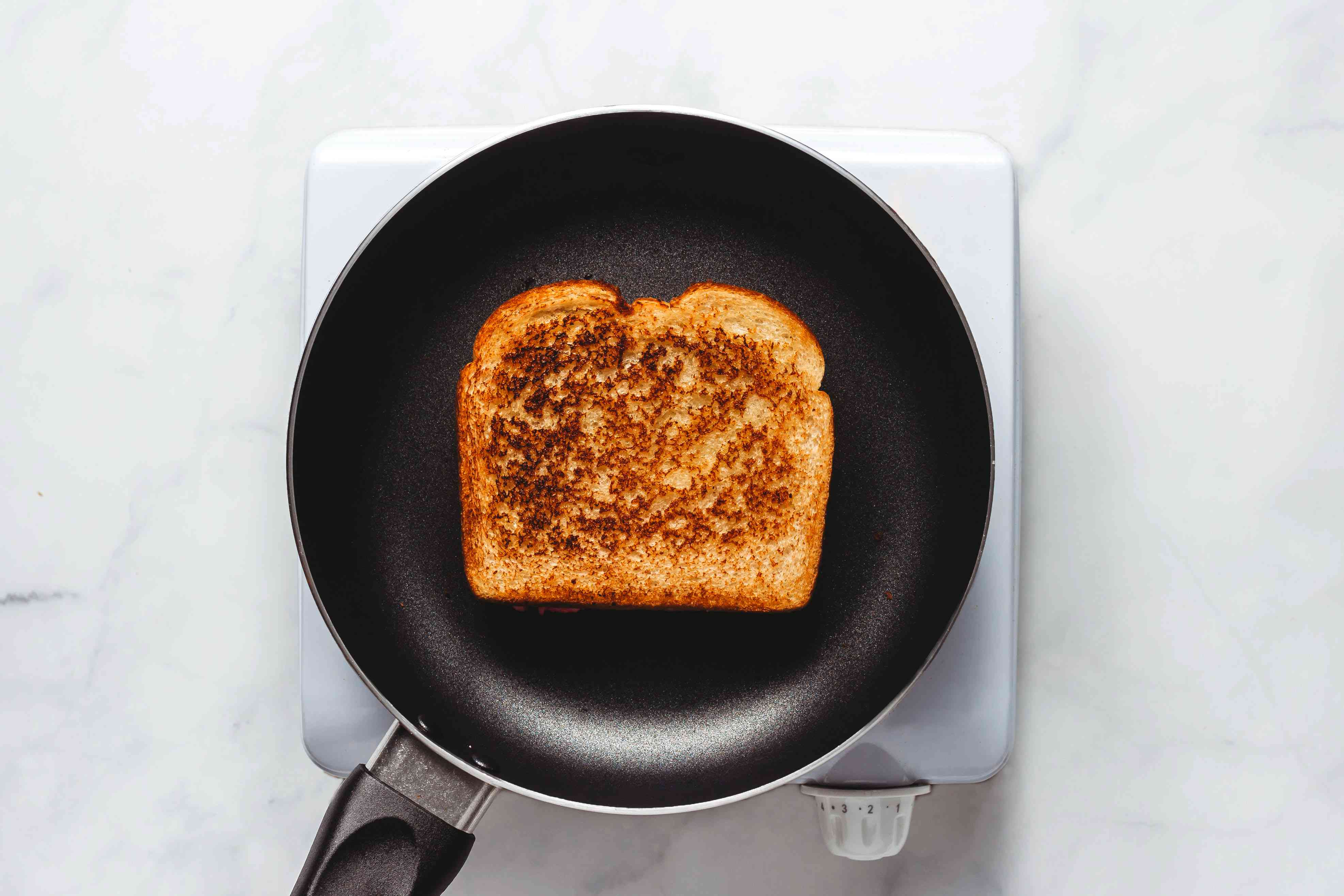 grilled cheese browned on one side in pan
