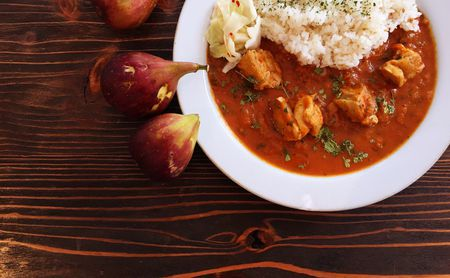 directly above shot of chicken curry with rice in plate on table