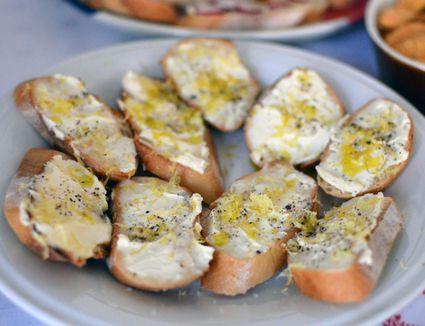 Fresh ricotta crostini with lemon zest, extra-virgin olive oil, black pepper, and fleur de sel