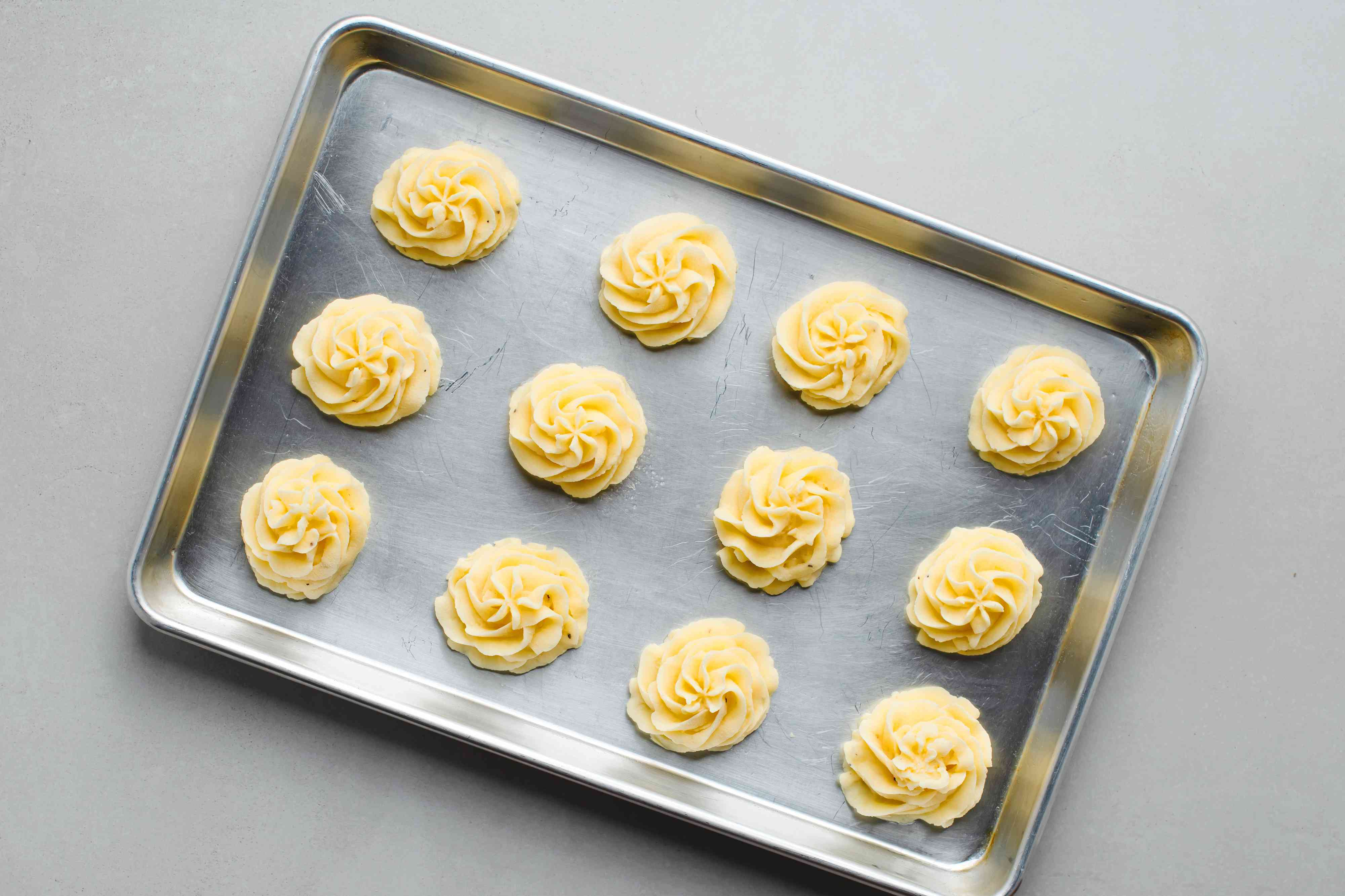 potato portions on a baking sheet