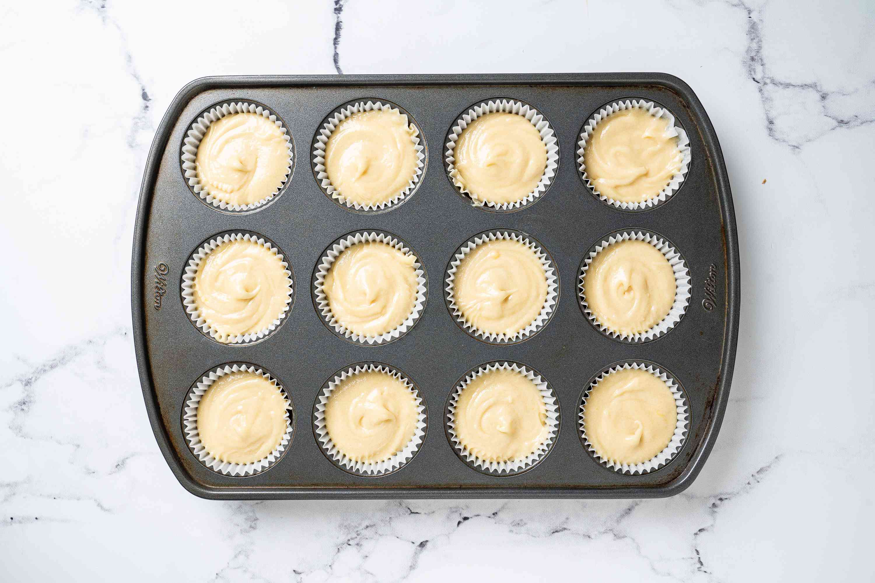 Unbaked cupcakes in a muffin tin
