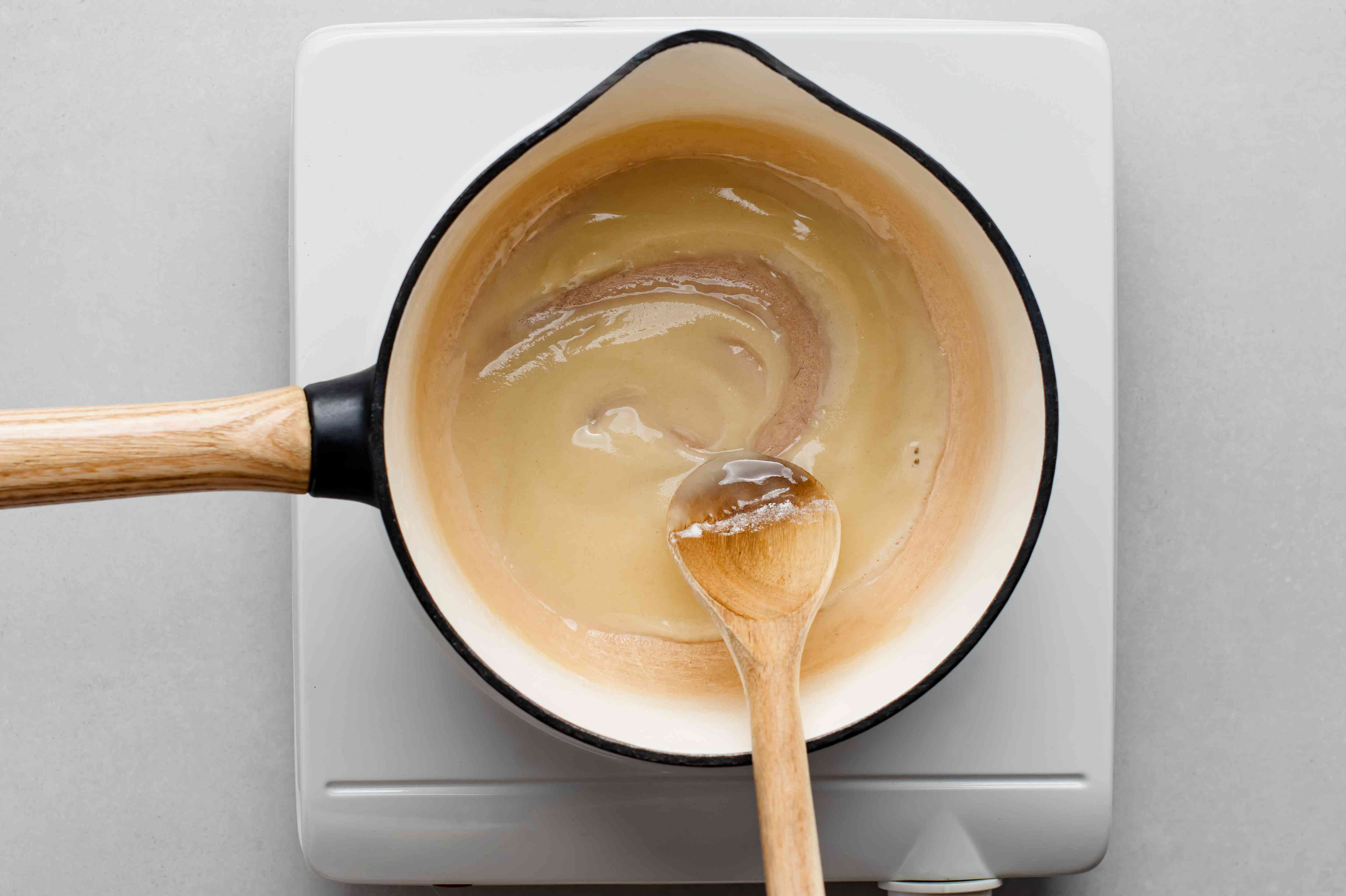 flour and oil in a pan, roux in a pan