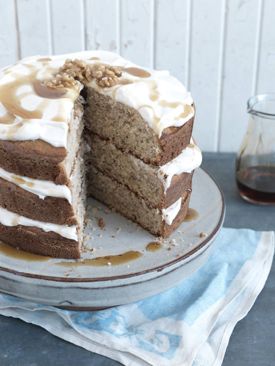 Layered Cake with Frosting, Drizzle, and Walnuts