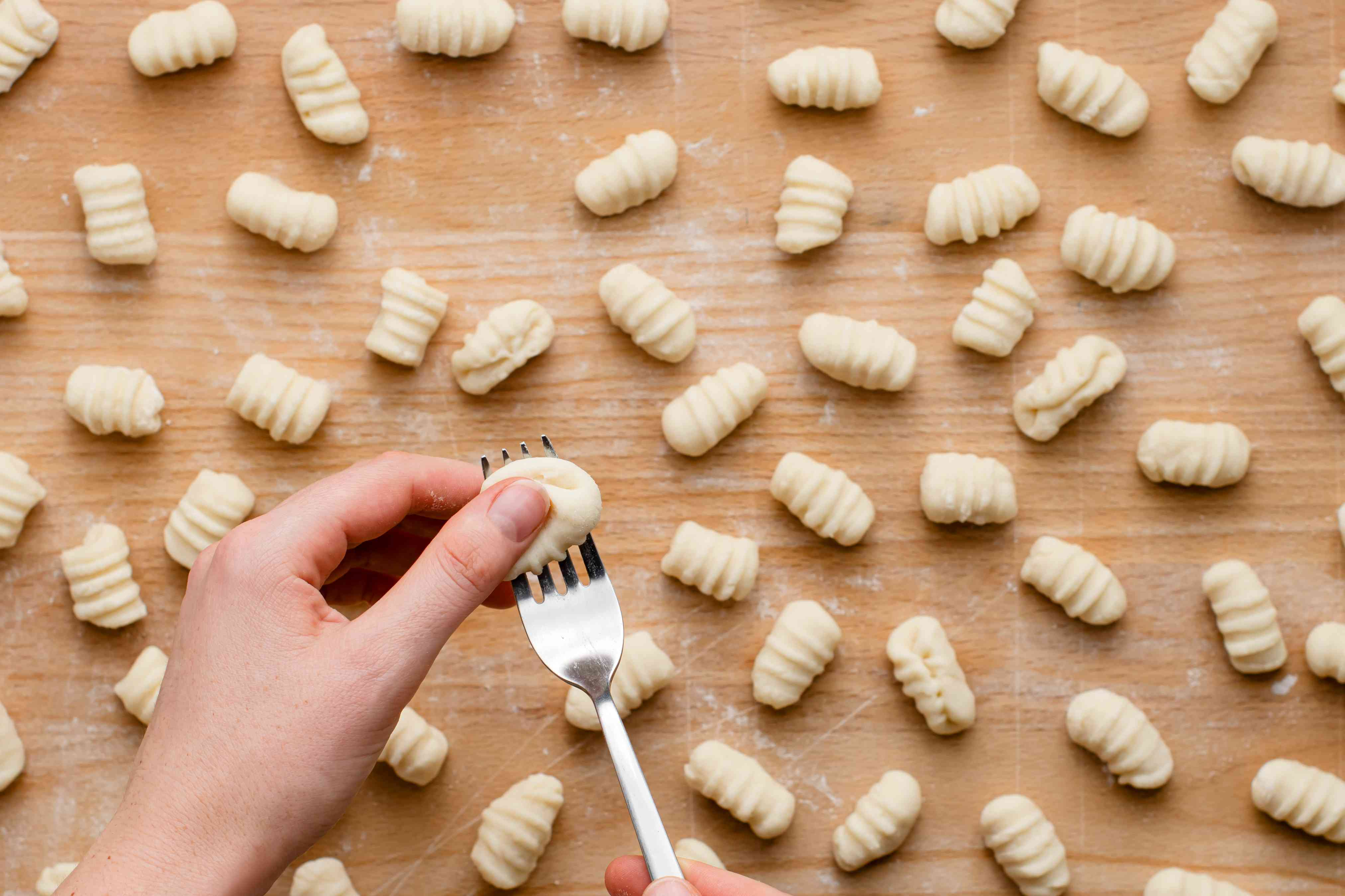 Shaping potato gnocchi with a fork