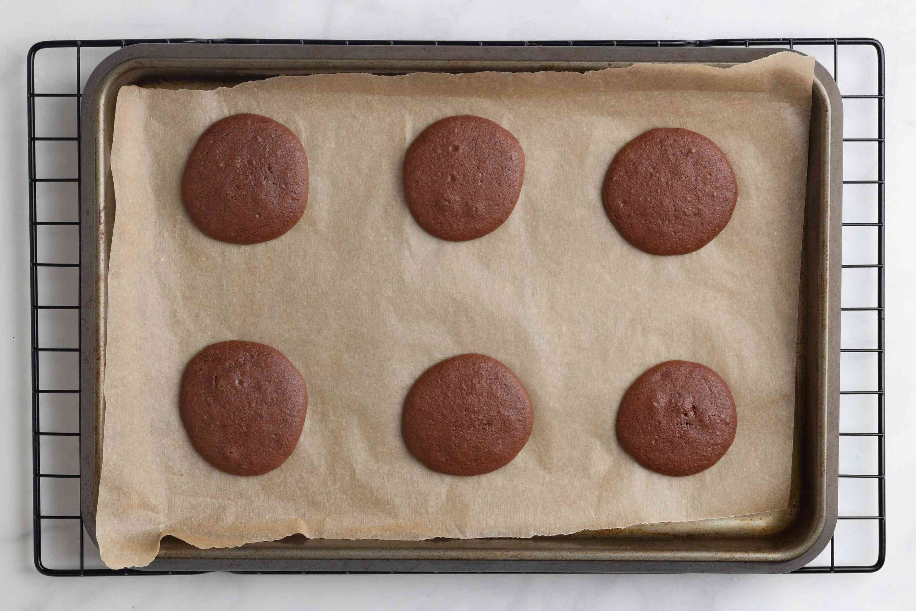 cookies on a baking sheet on a cooling rack