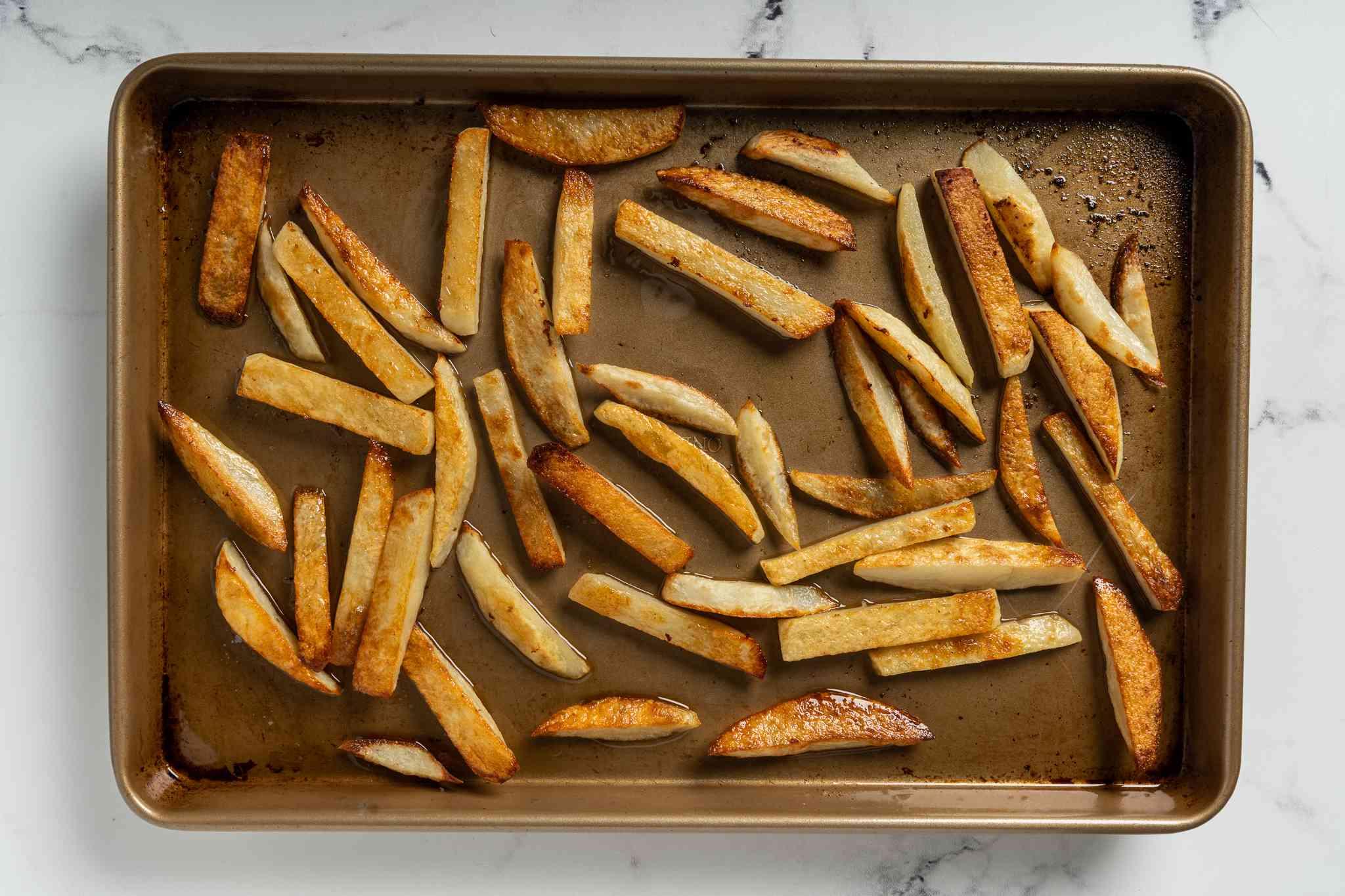 baked potato strips on a baking sheet