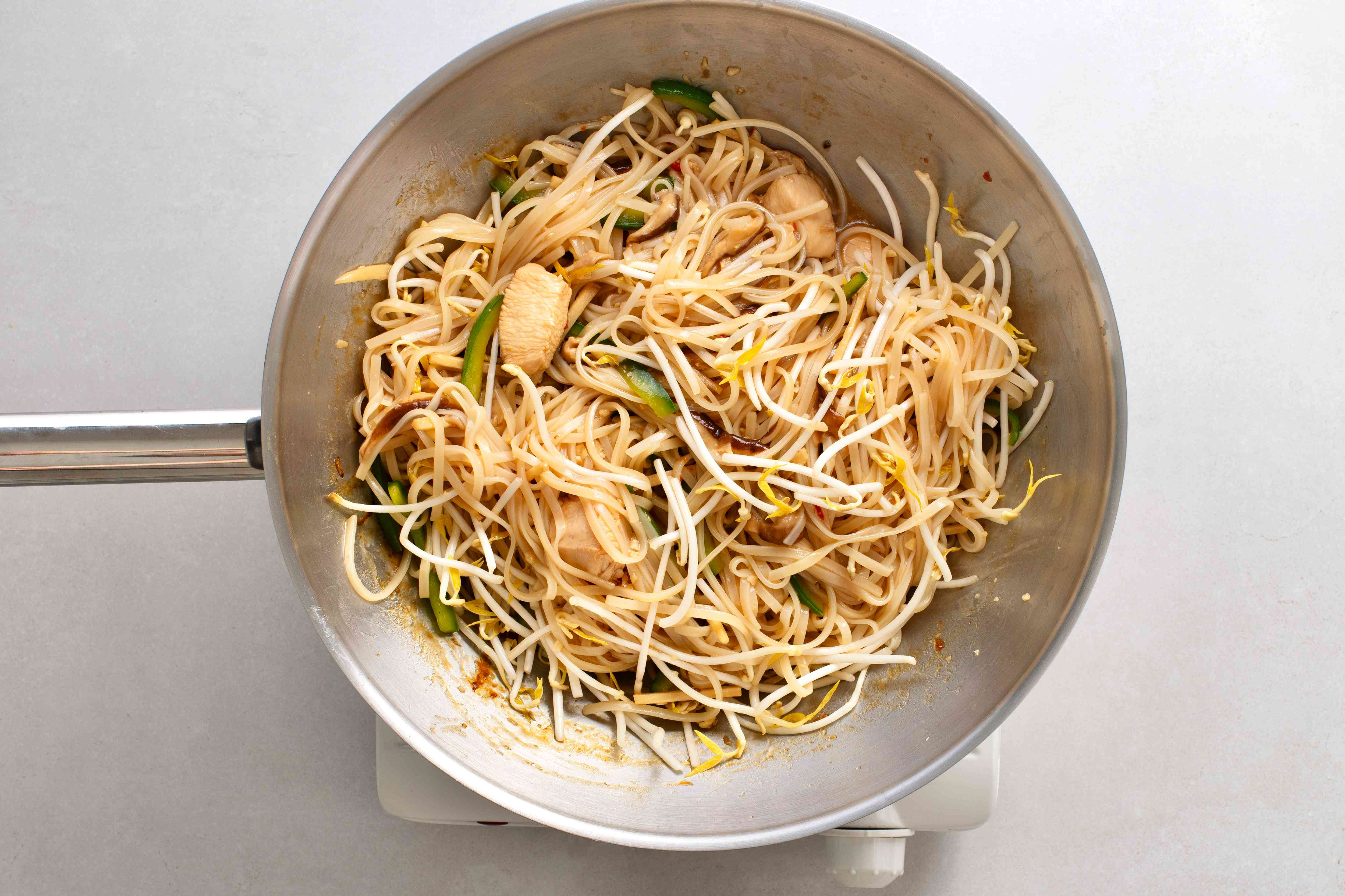 add bean sprouts to the mixture in the pan