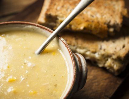 Close-up of chicken corn soup in bowl and bread