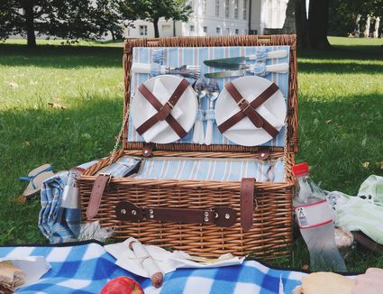 View Of Picnic Basket On Field - stock photo