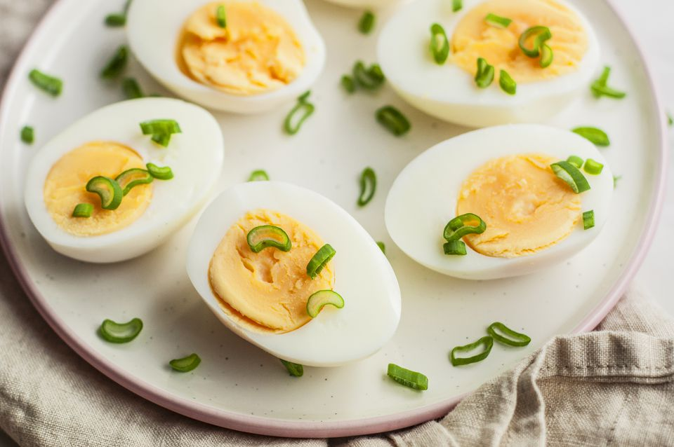 Hard-boiled eggs with green onion garnish