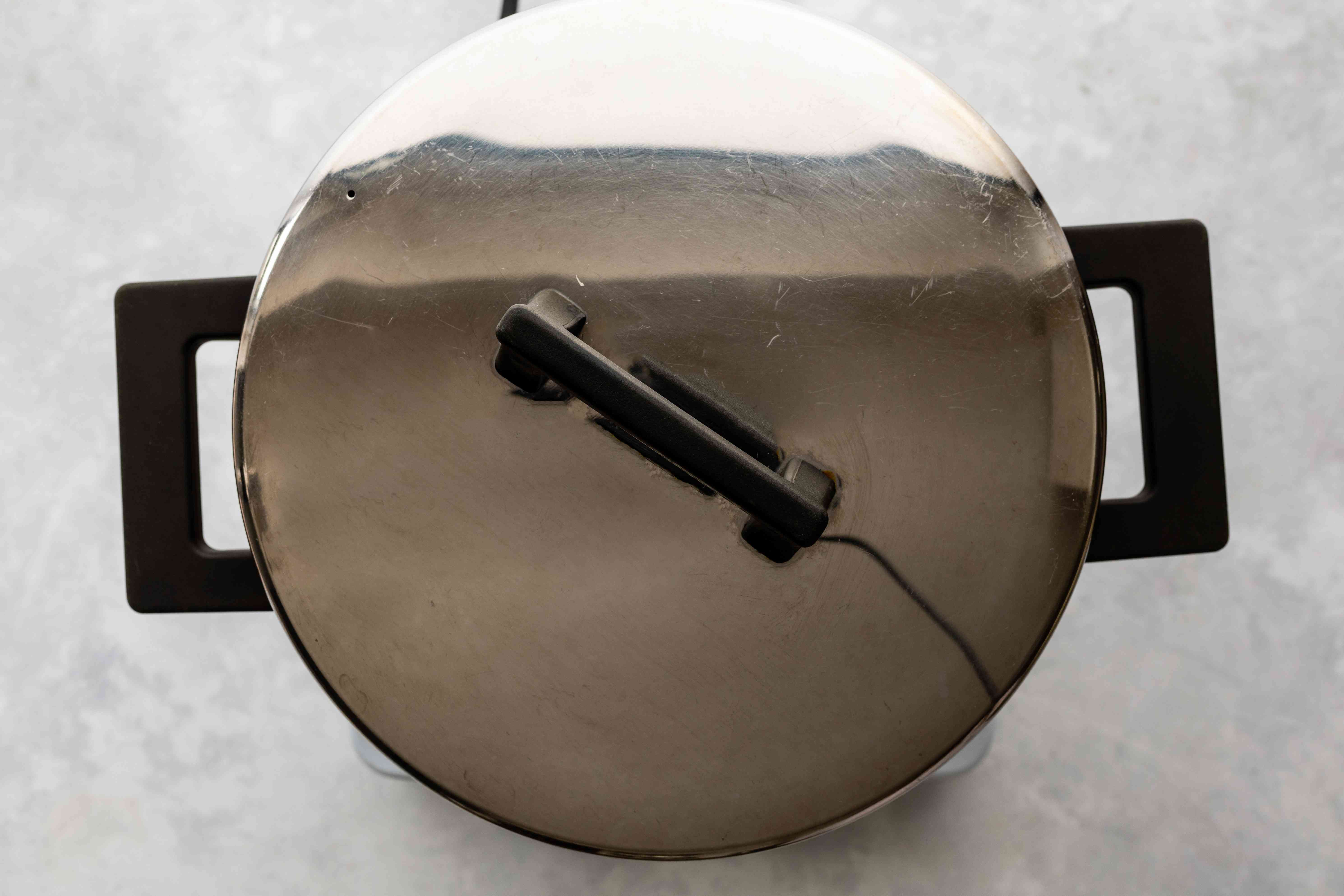 Place cover over saucepan