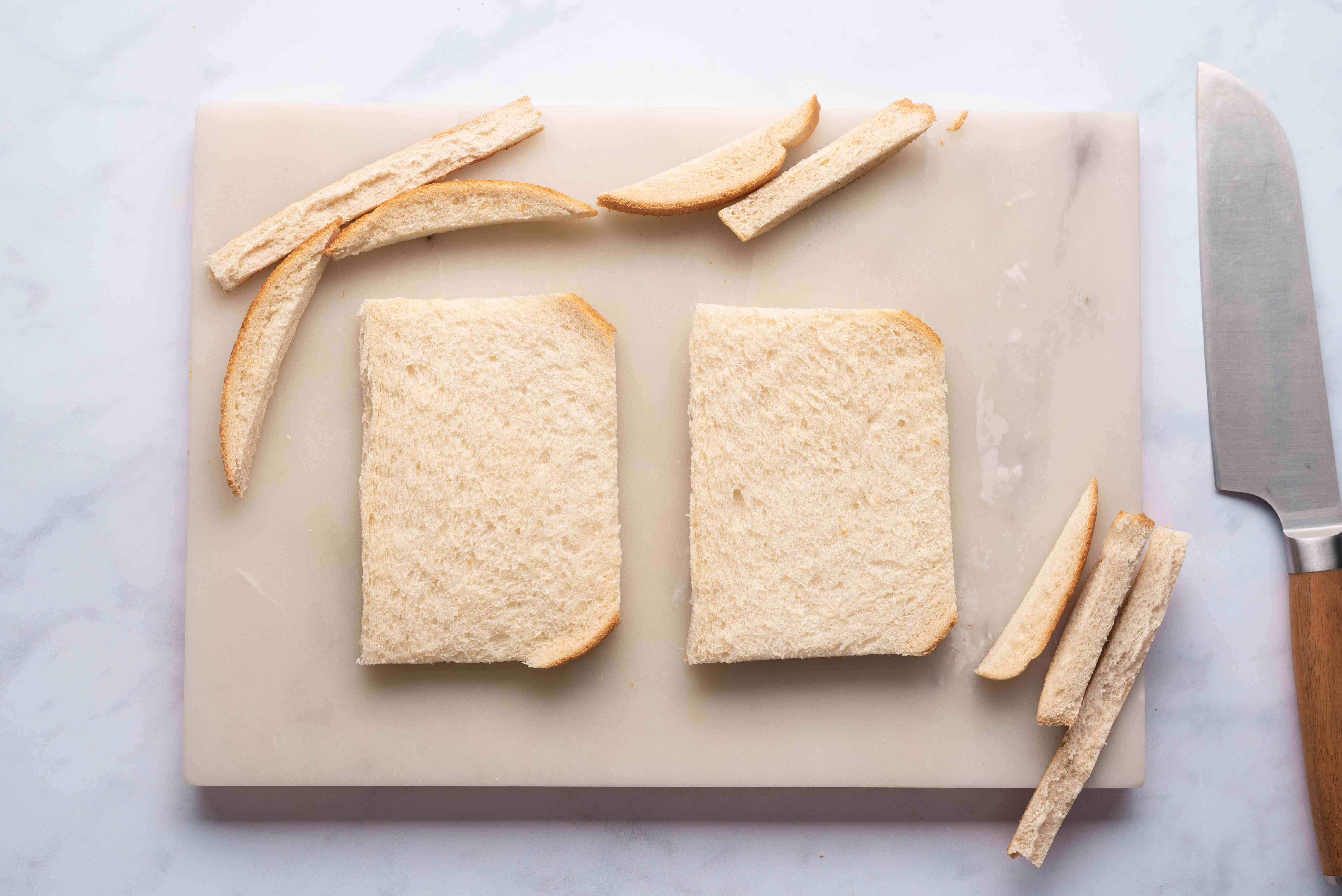 Trim the crusts off of the bread