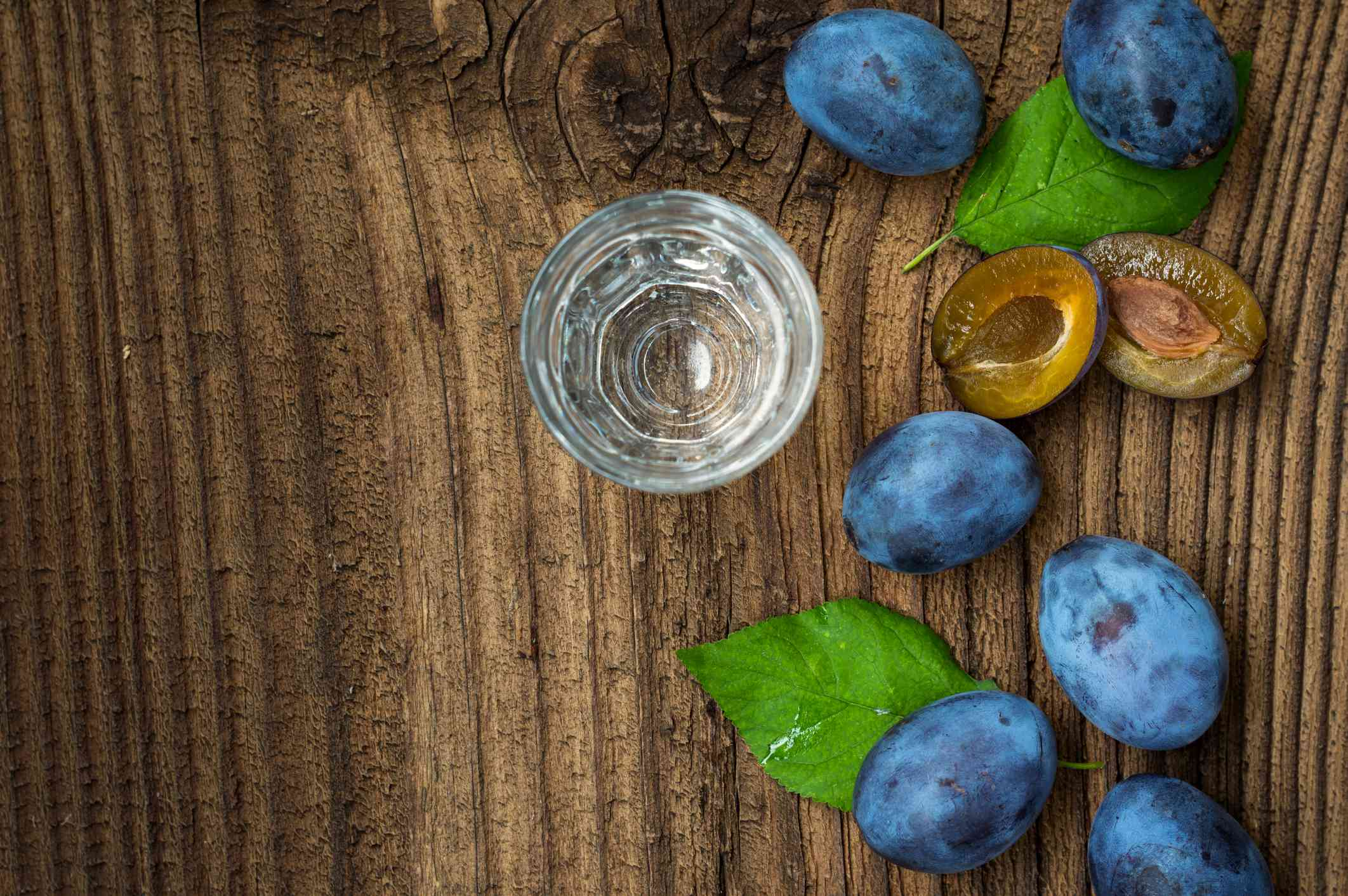 Plums and shot glass