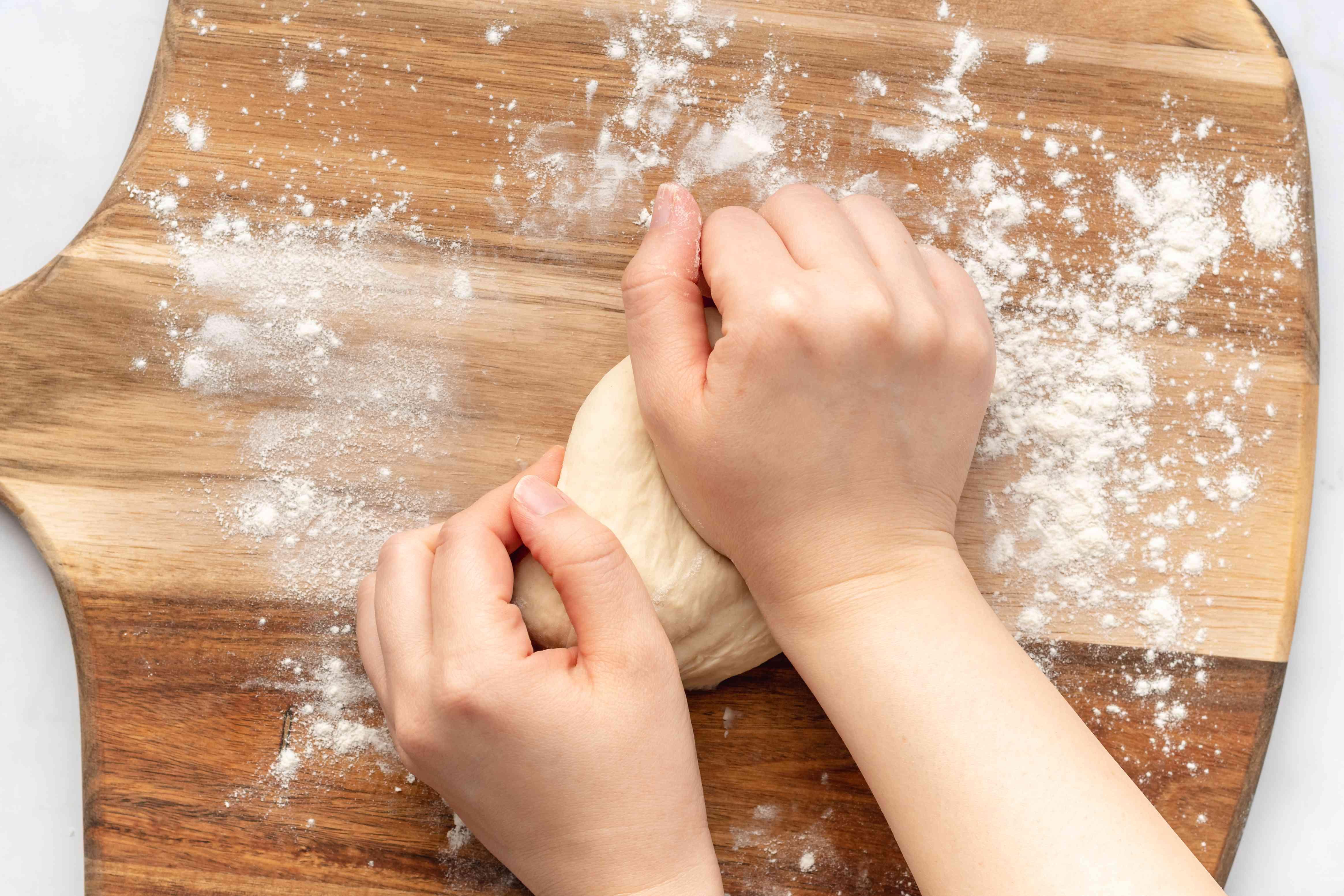 knead dough on a floured wood board