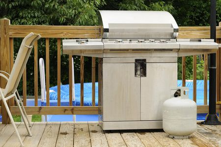 Gas Grill And Propane Tank