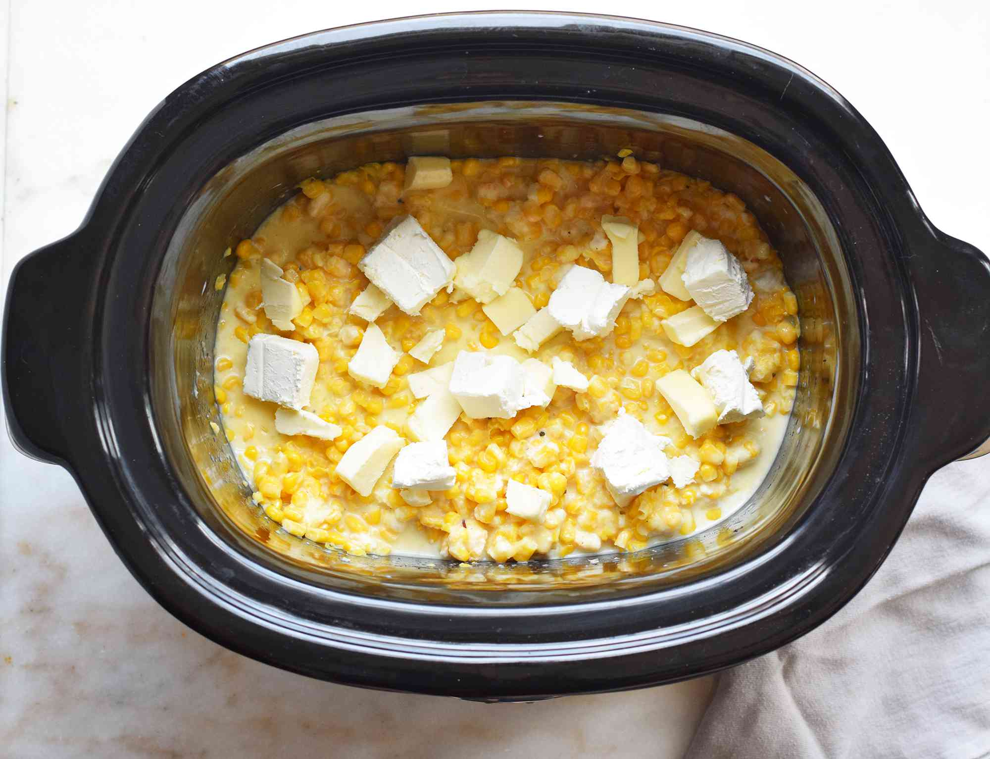 creamed corn topped with cream cheese and butter