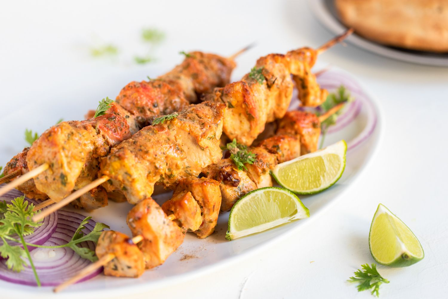 Remove from skewers and put the chicken on a plate.