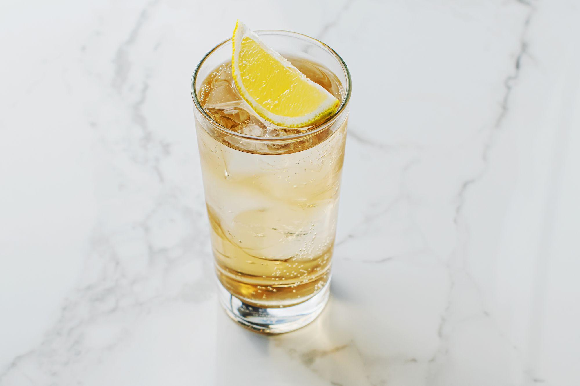 Gin buck garnished with lemon wedge