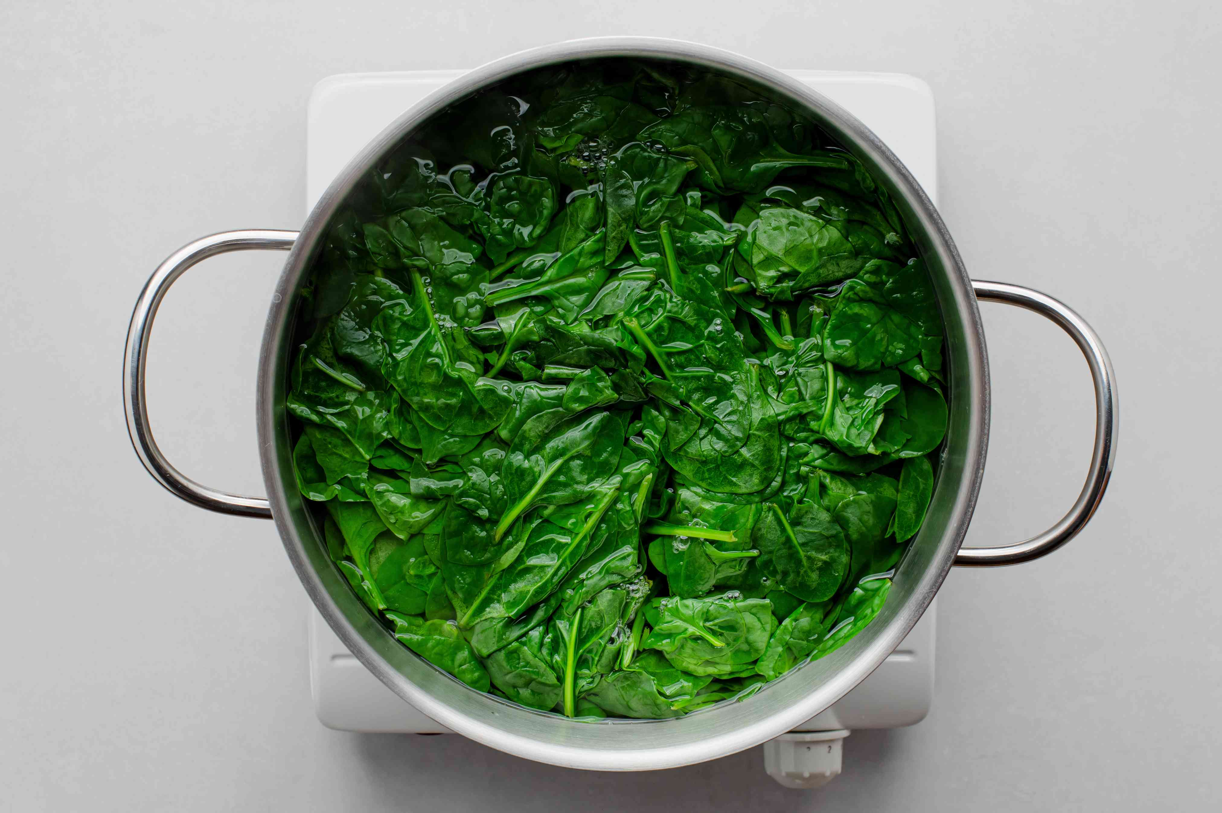Blanch the spinach in boiling water