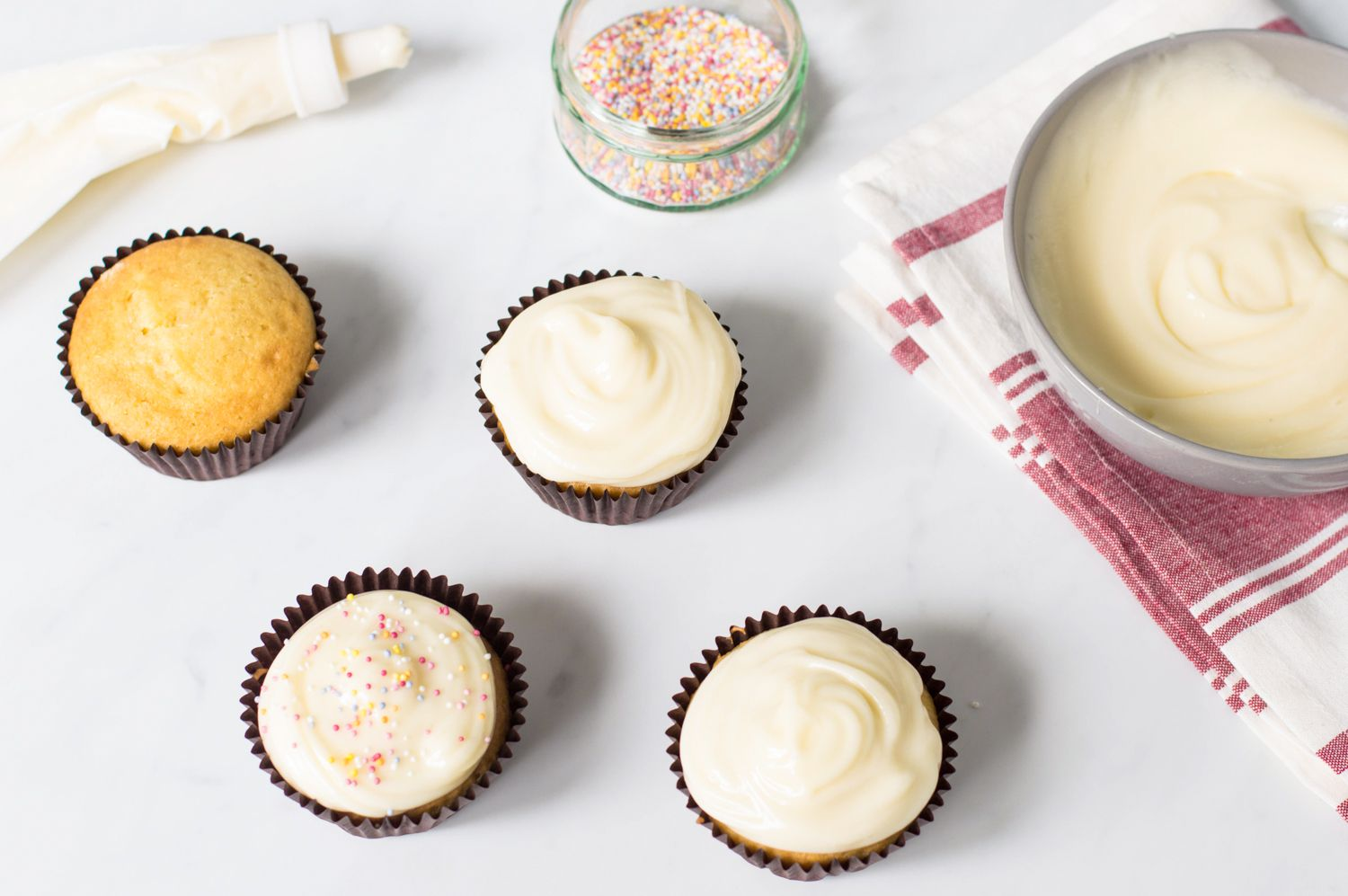 Homemade cream cheese frosting on cupcakes