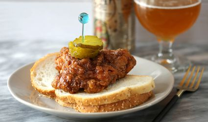 Nashville hot chicken recipe with pickles, bread, and beer