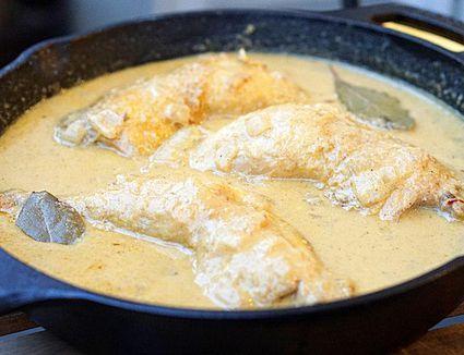 Simmering chicken in pepitoria sauce.