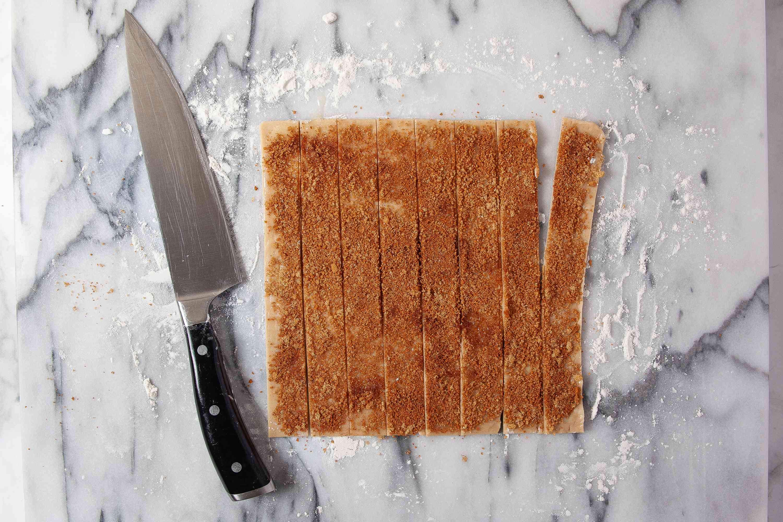 Dough cut into strips for apple pie bites