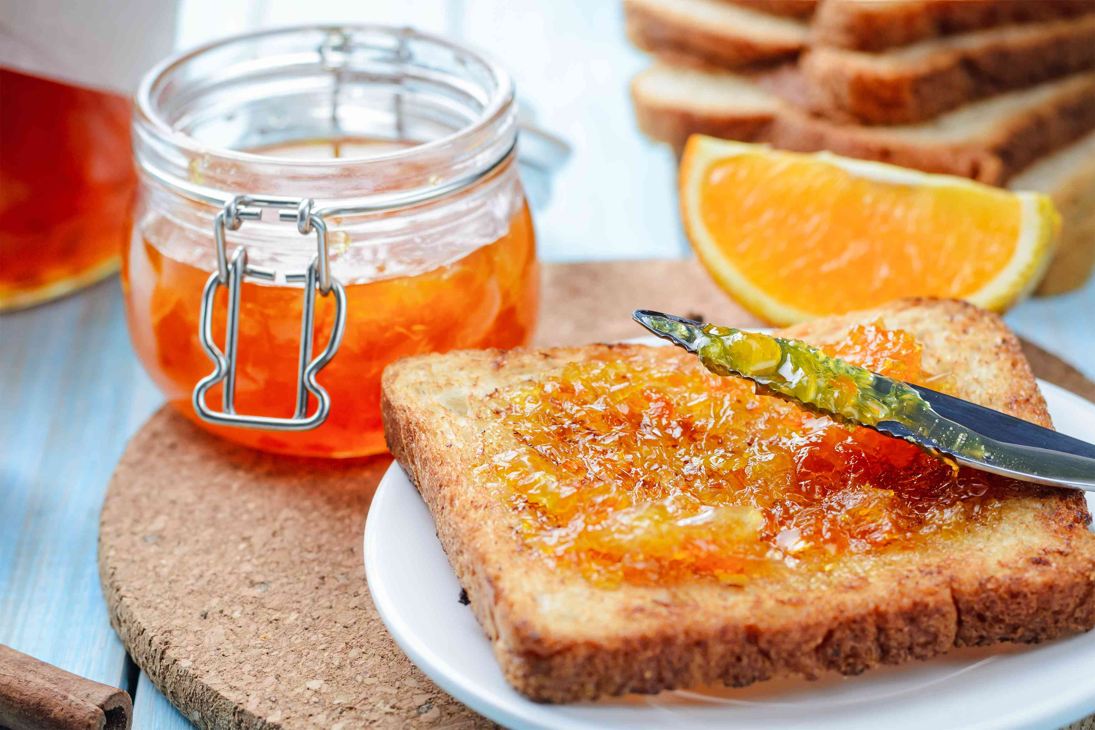 Slices of toasted bread with orange jam for breakfast