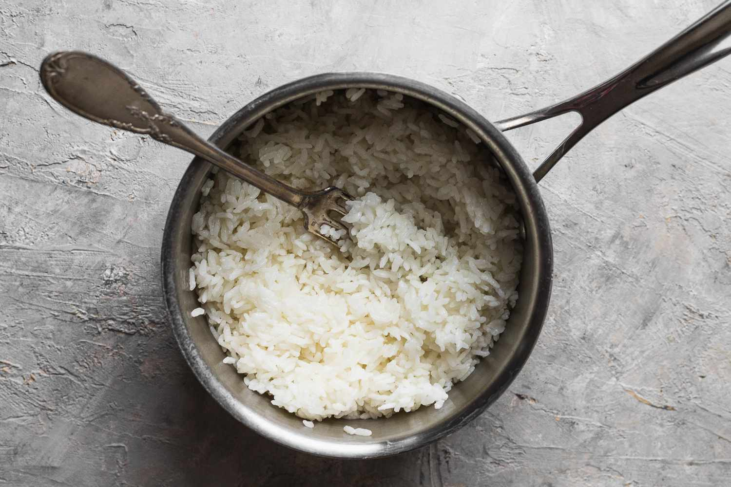 rice in a saucepan fluffed with fork