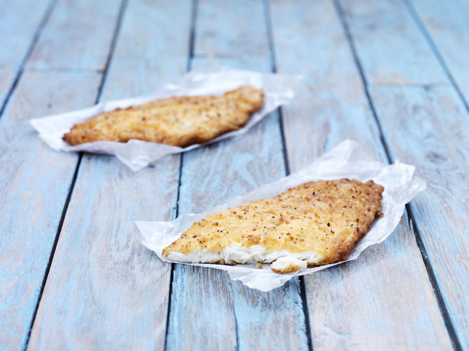 A pair of fried white fish