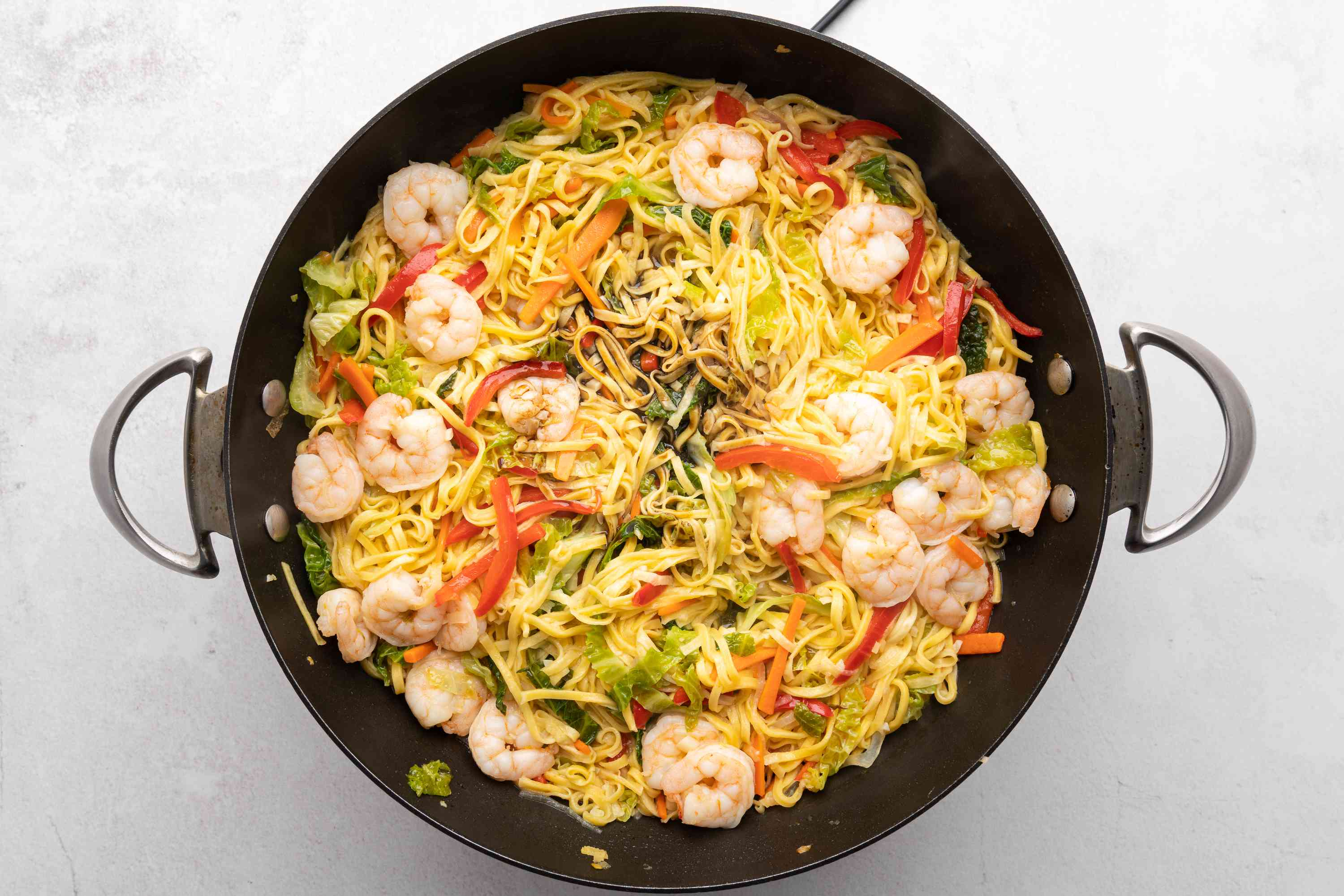Traditional Filipino Pancit cooking in a wok