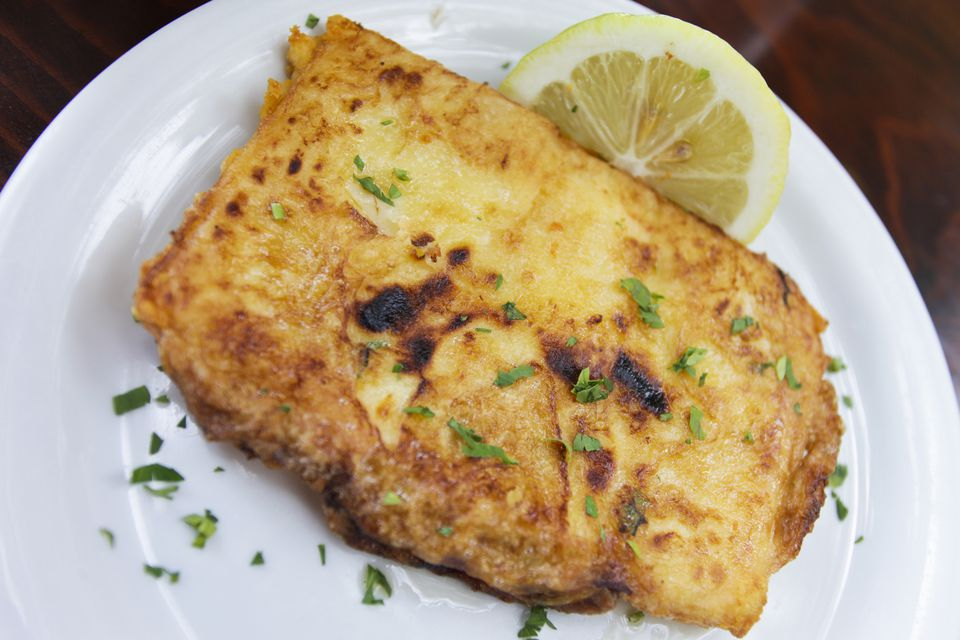 Saganaki on a plate with lemon