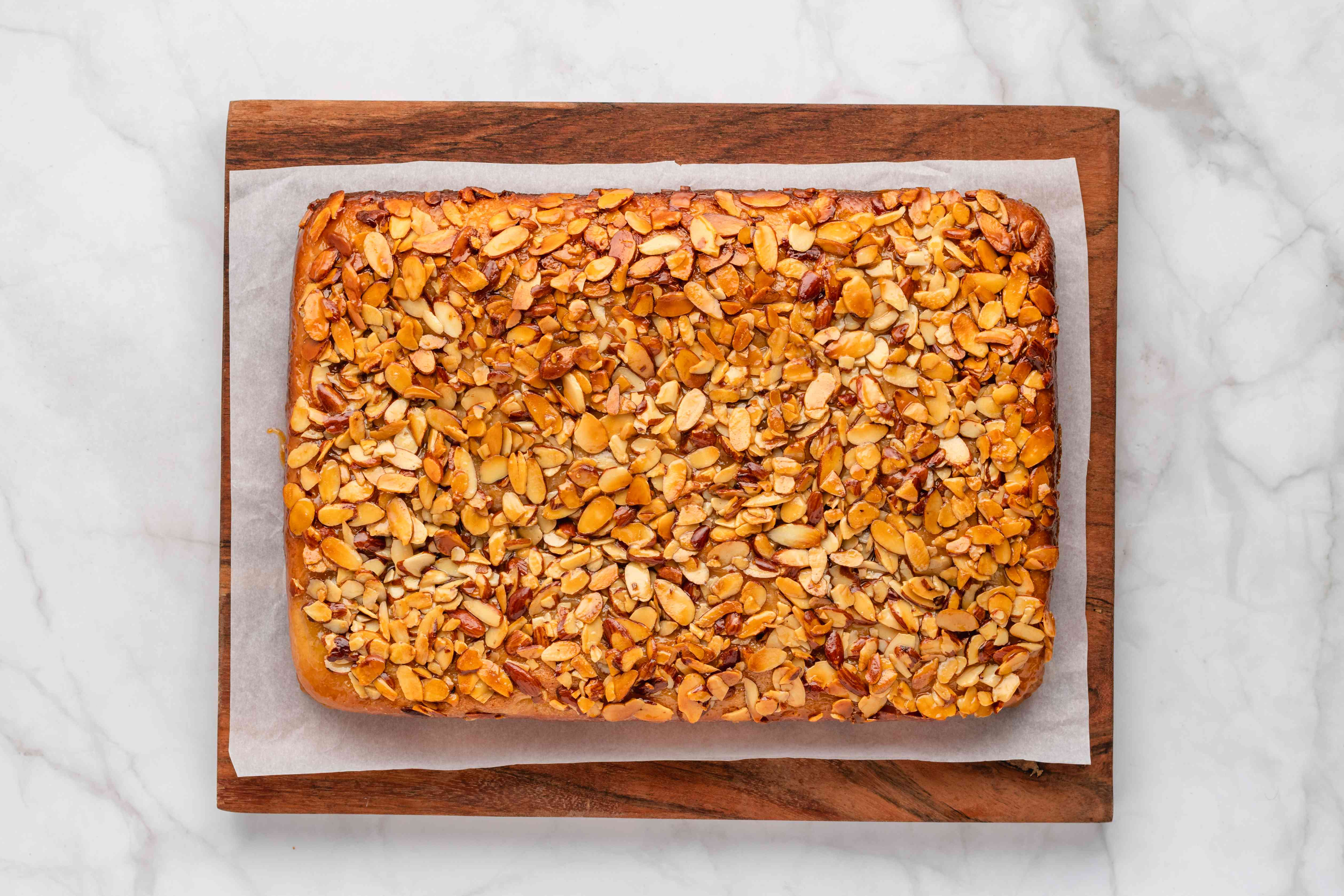 baked cake with almond topping on top