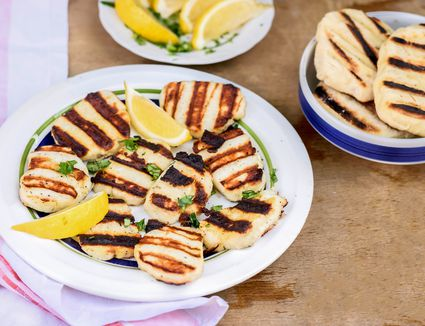 Grilled Halloumi Cheese on plate with lemon wedges