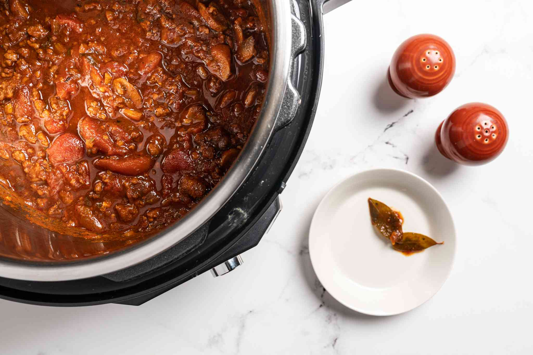 pasta sauce in a pressure cooker, bay leave removed