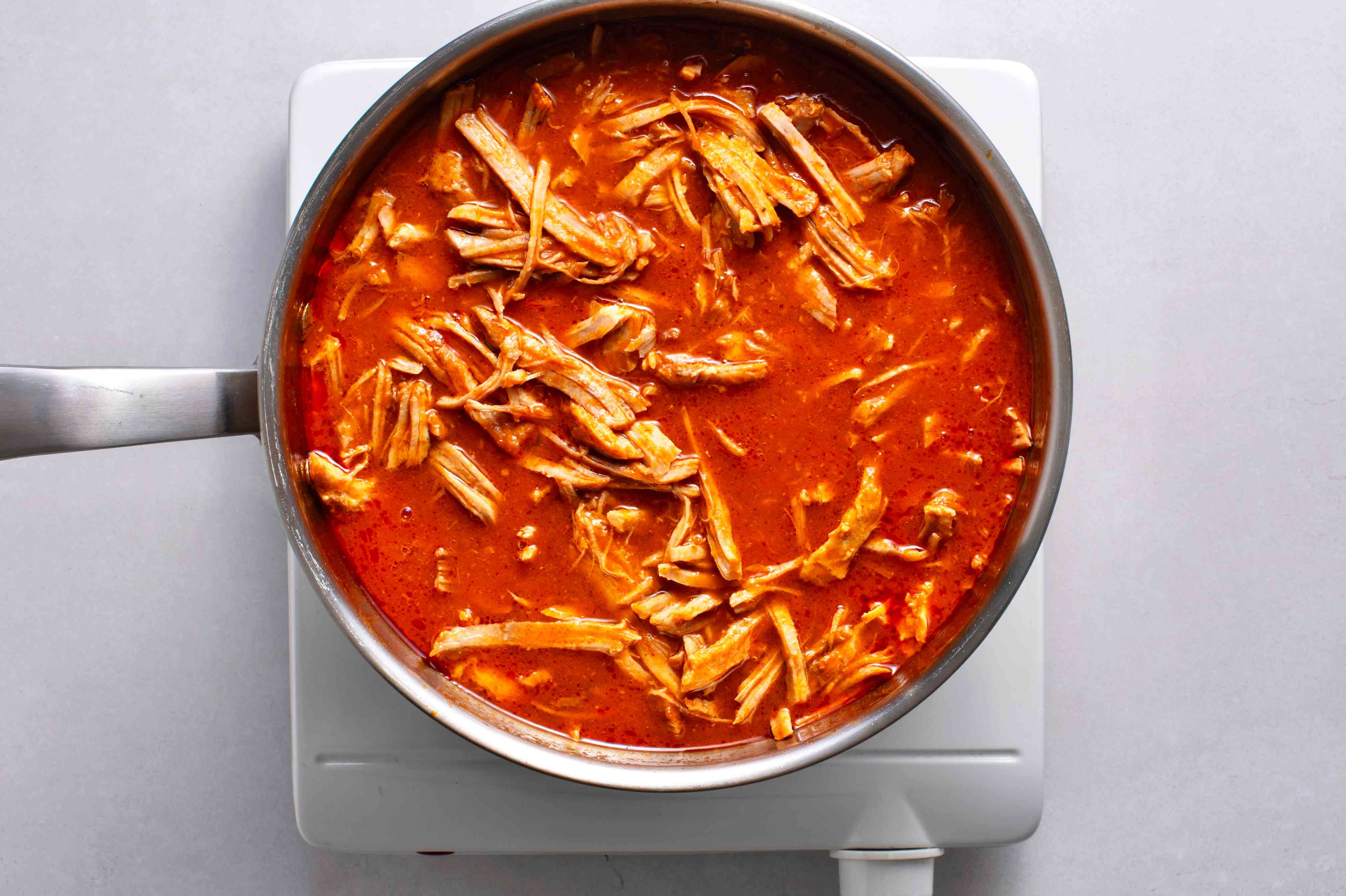 shredded pork with sauce in the pot