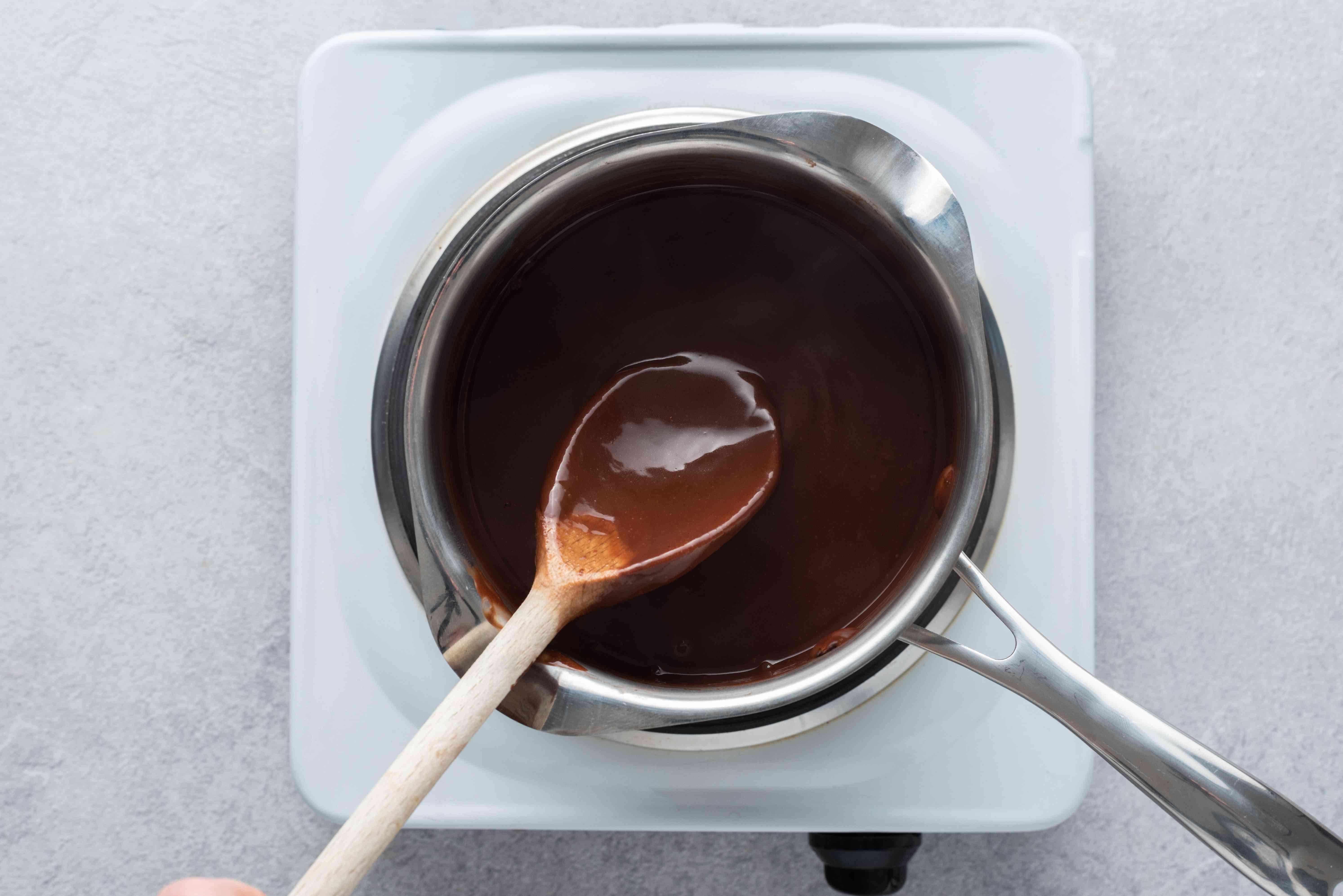 stir the vegan pudding in the saucepan