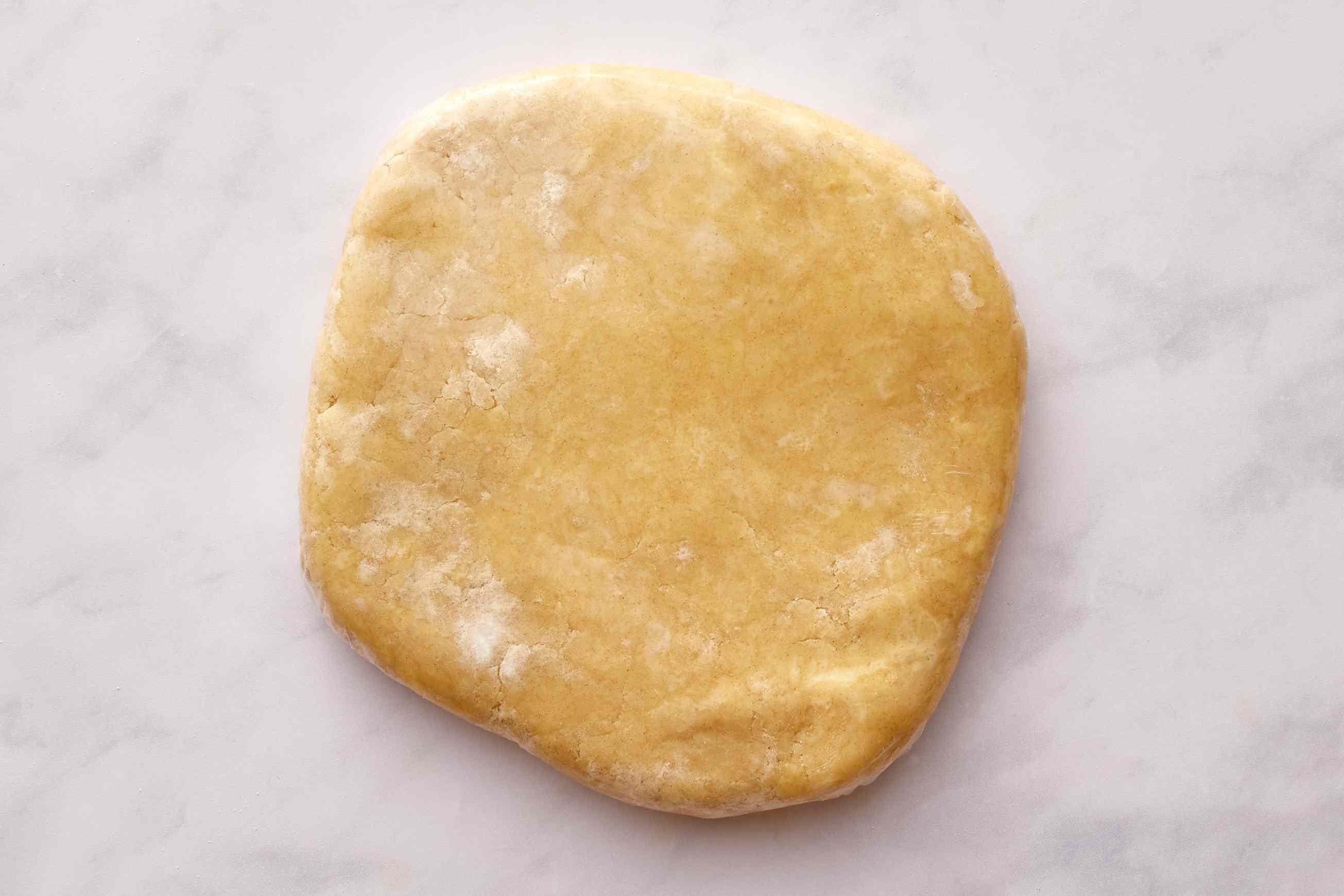 Buttery Flaky Pie Crust on a floured surface