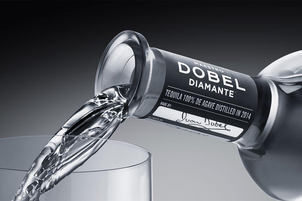 Maestro Dobel Diamante Tequila being poured into glass.
