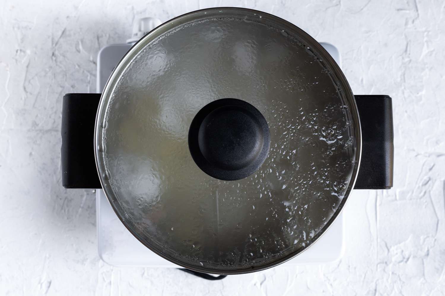 Potatoes simmering in a pot of water