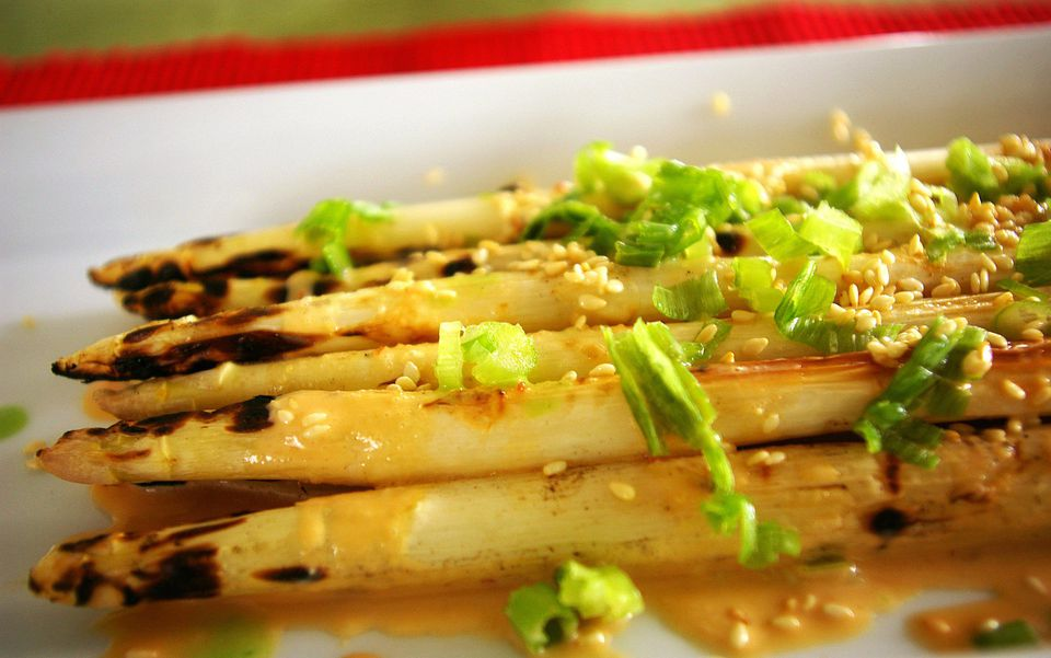 Grilled white asparagus with toasted sesame seeds and garlic-soy cream
