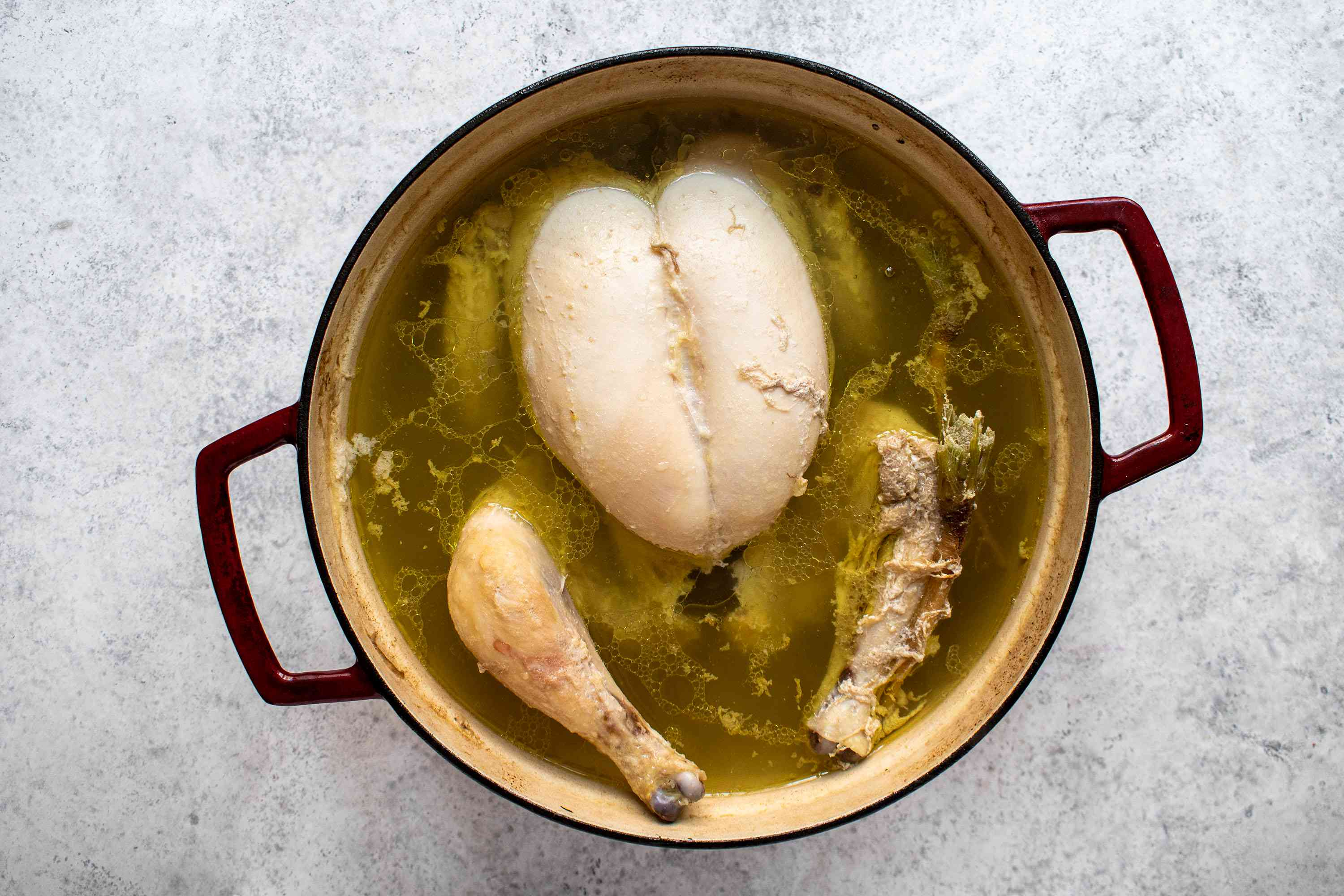 chicken cooking in a pot of water